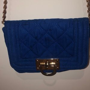 Blue quilted crossbody bag with chain strap